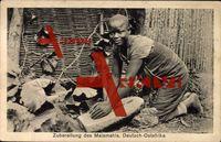 Volkstypen Deutsch Ostafrika, Frau bereitet Maismehl