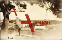 Hvar Kroatien, Blick auf Mann und Frau an Küste