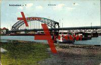 Schönebeck a.d. Elbe, Seitenansicht der Brücke, Ufer; gelaufen 1914, Ecken bestoßen, fleckig, sonst guter Zustand; PLZ 39218
