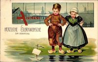 Glückwunsch Geburtstag, Kinder in Trachten, Spielzeugboot