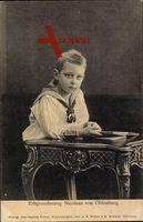 Erbgrossherzog Nicolaus von Oldenburg am Tisch sitzend