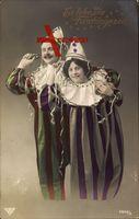 Es lebe die Faschingszeit, Frau und Mann in Clowns Kostümen,