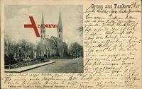 Berlin Pankow, Blick von der Straße auf Brunnen und Kirche