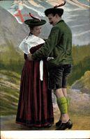 Paar in bayrischen Landestrachten, Lederhosen, Federhüte