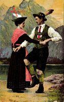 Zwei Bayern in Landestrachten beim Tanzen, Paartanz, Lederhosen