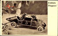 Glückwunsch Pfingsten, Maikäfer auf einem Modellauto