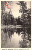 Blick vom Stiftsteich auf die Kirche im Evangelischen Johannisstift in Berlin Spandau um 1943