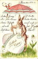 Glückwunsch Ostern, Osterhase malt Osterei an, Schirm