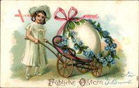 Glückwunsch Ostern, Mädchen, Großes Osterei auf einer Schubkarre
