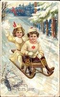 Glückwunsch Neujahr, Junge und Mädchen auf Schlitten