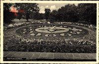Hermannsbad Polen, Ansicht einer Blumenuhr im Park