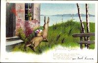 Glückwunsch Ostern, Osterhase mit Ostereiern auf dem Rücken