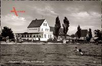 Neustadt Ostsee, Blick aus dem Wasser auf das Hotel Strandhalle, Badende