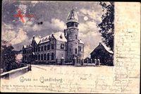 Quedlinburg im Harz, Straßenpartie mit Blick auf die Post, Winter, Mond