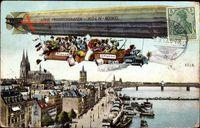 Köln am Rhein, Zeppelin über der Stadt, Brücke, Dom im Hintergrund
