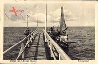 Seeheilbad Zingst an der Ostsee, Segelboot am Brückenkopf, Seebrücke