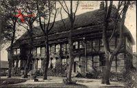 Isenbüttel, Straßenpartie mit Blick auf das Ritterhaus, Fachwerkhaus